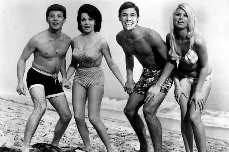 Still under contract with Walt Disney, famous Mouseketeer Annette Funicello was asked that she cover her navel while filming this quintessential beach-party movie in order to maintain her girl-next-door image. Thankfully for us, her high-waisted bikini played by the rules and still made us all want to join in the fun.    - ELLE.com