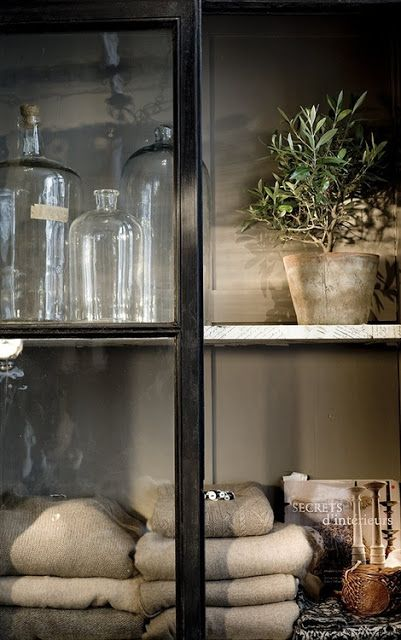 What is it about this that I love? The door? The worn pot? The olive tree? The color and texture? Great bottles? Gorgeous!