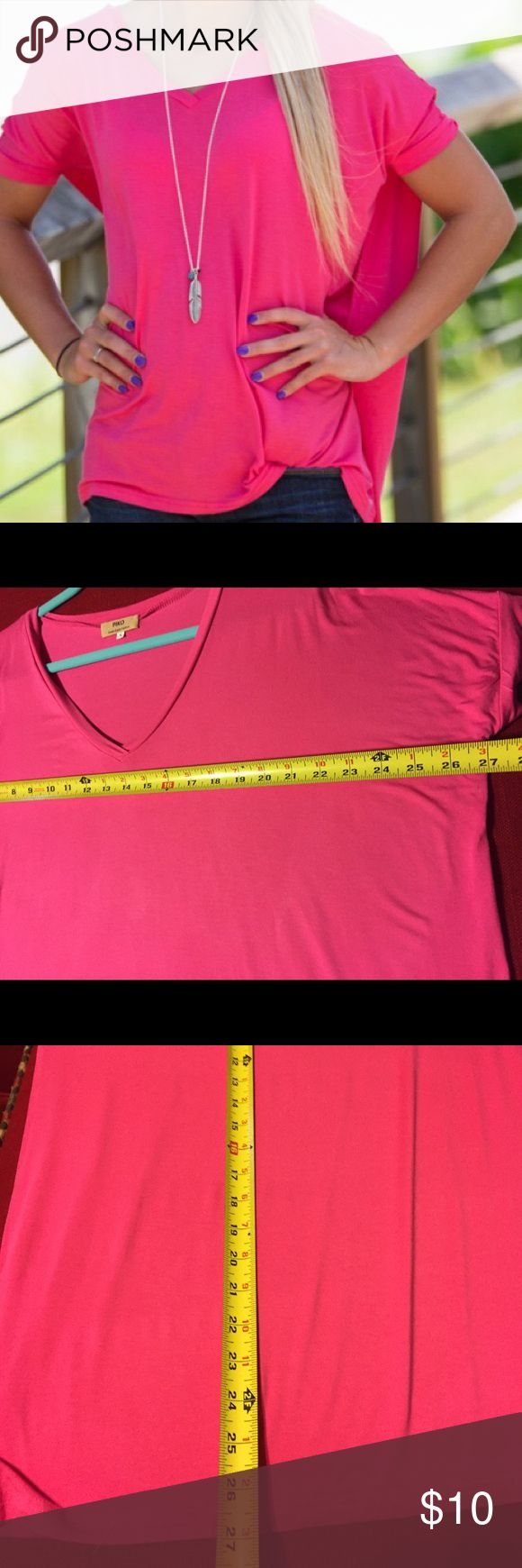 Piko hot pink, short sleeve, v-neck top So soft! Piko has the perfect fabric recipe for comfort: 95% bamboo and 5% spandex. This v-neck, short sleeve hot pink top has a slouchy, oversized fit and fitted sleeves. Wear it casual or dress it up! Great condition! Piko Tops Tees - Short Sleeve