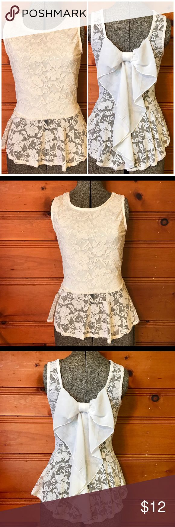 🎀Lacey Bow Tank Top🎀 Absolutely Gorgeous White Lacey Top w/ Bow that flows down the back! Sheer on the bottom lace and the back. The front has a silky lining. Bundle TWO or more listings to save 15%! 🎀 Joyce Leslie Tops Tank Tops