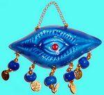 Ojo y mano amuletos de suerte