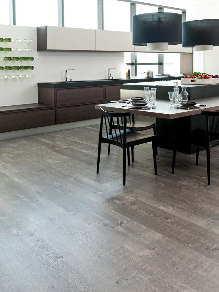 A sophisticated vinyl link flooring material you may even be able to go over the existing tile. Need to see the transition between flooring materials.   How to install Linkfloor: a vinyl material by L'Antic Colonial which is ideal for reforms