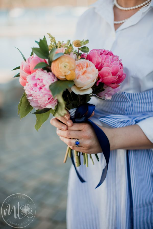 Bouquet For Nautical Wedding In Coral Pink Peach And Yellow Made With Peonies Ranunculus Garden Roses Wedding Wedding Florist Nautical Wedding Decorations