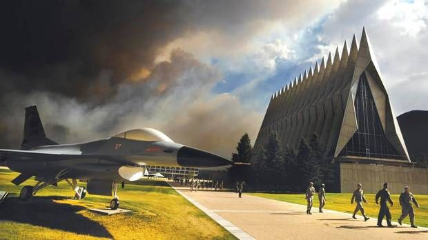 Smoke from the Waldo Canyon Fire rises near the USAF Academy's Cadet Chapel as cadets head for a briefing on evacuation procedures, June 27, 2012. U.S. Air Force