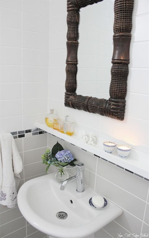 Rethink picture ledges, because they can be used to hold way more than just art. Here, IKEA's picture ledges add missing sink storage to a small bathroom.