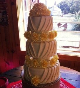 GREAT cake tutorials on this blog!  She explains well how to make this pleated cake and the roses, as well as many other things.