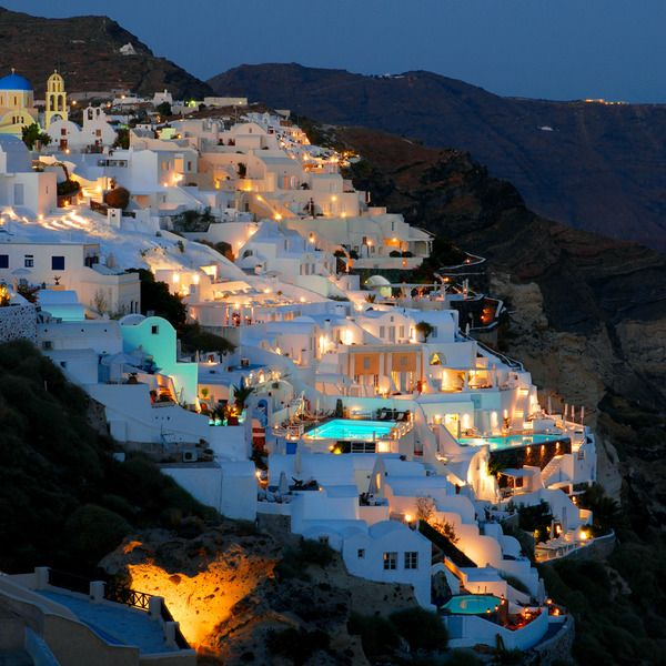 Santorini, Greece. Everything is romantic on Santorini. The white walls of the archipelago's houses, charming little streets, beautiful gardens, excellent cuisine, domestic wine, dazzling sea, golden cliffs, spectacular sunsets and fantastically relaxed Mediterranean atmosphere.