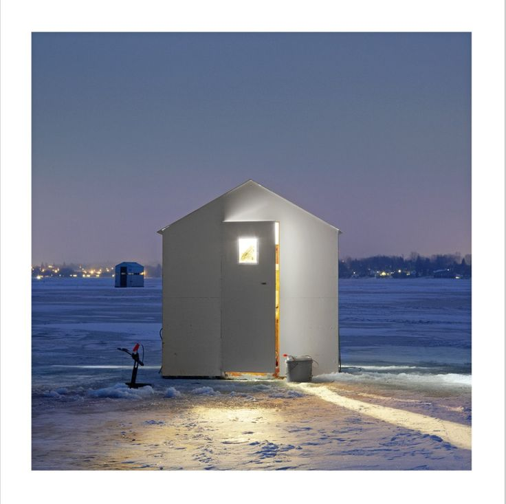 Richard Johnson, Ice Huts series - only one of the thousand photos that was taken at night.  love the door slightly open, adds intrigue and makes you wonder what is going on inside.