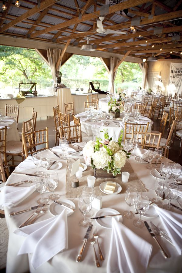 Burlap square in the center of round tables, and burlap runners on farm tables.....