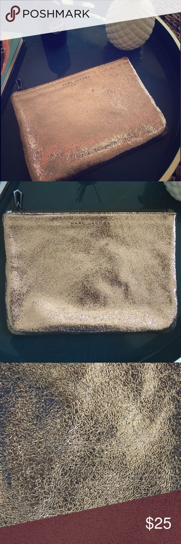 Adorable Marc Jacobs Gold Clutch Bag This adorable Marc Jacobs clutch bag is great for a night out or can do double duty as a makeup bag! It is in good used condition, showing only slight signs of wear in the fabric. A beautiful bag for a great price. Marc Jacobs Bags Clutches & Wristlets