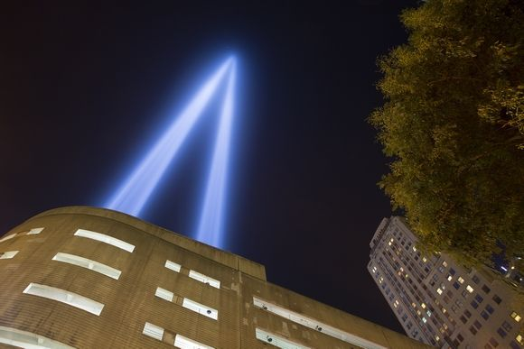 The Tribute In Light shines skyward from the top of the Battery Parking Garge several blocks south of the WTC site on September 11, 2014Photo By: Robert Breese/For the Times Herald-Record
