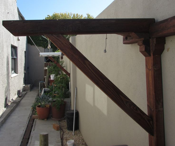 Washing line bracket made of pallet wood.