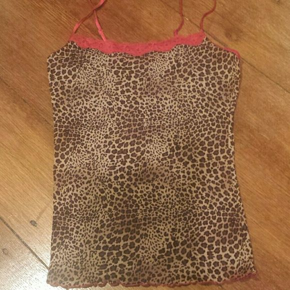 Shop Women's Brown Red size S Tank Tops at a discounted price at Poshmark. Description: No tags but the brand might have been Rampage. Mesh, sexy, super stretchy tank top with spaghetti straps, in cheetah print. Has red lace at the top and red lettuce edge hem. Really cute as a pajama top or just for everyday in the summer. Can fit xs to m. Bust is 13.5 to 18 inches. I have a matching skirt for sale.. Sold by jlq929. Fast delivery, full service customer support.