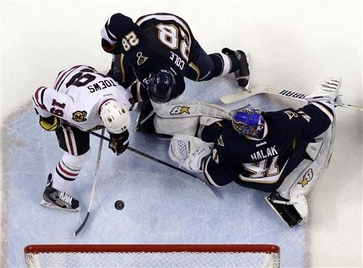Chicago Blackhawks' Jonathan Toews, left, scores his second goal of an NHL hockey game as St. Louis Blues goalie Jaroslav Halak, of Slovakia, and Ian Cole, center, defend during the third period, Thursday, Feb. 28, 2013, in St. Louis. The Blackhawks won 3-0. (AP Photo/Jeff Roberson)