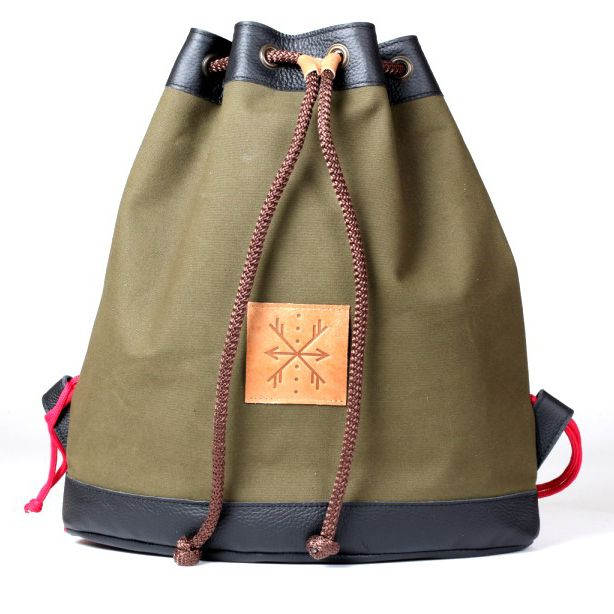 Capacious backpack: made of natural grain leather and cotton  fabric. Adjustable braces with colorful string. Color - green-black.