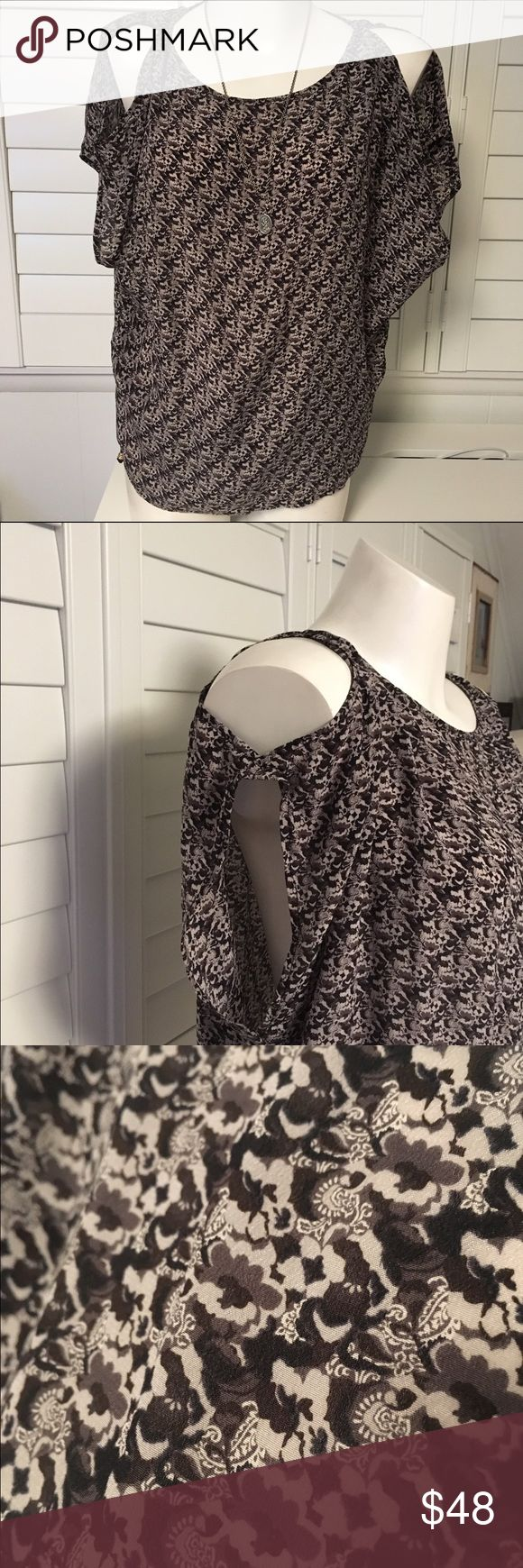 Joie Silk T-Shirt with shoulder cutouts Joie Silk T-Shirt with shoulder cutouts . NWOT dress it up or down. Perfect condition flowy silk with neutral color print. Joie Tops Blouses