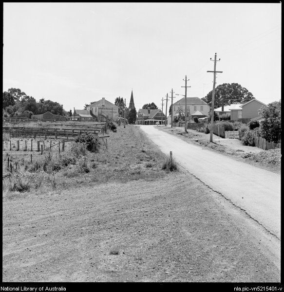 Street leading to houses, hotel and post office, Evandale, Tasmania, ca. 1970