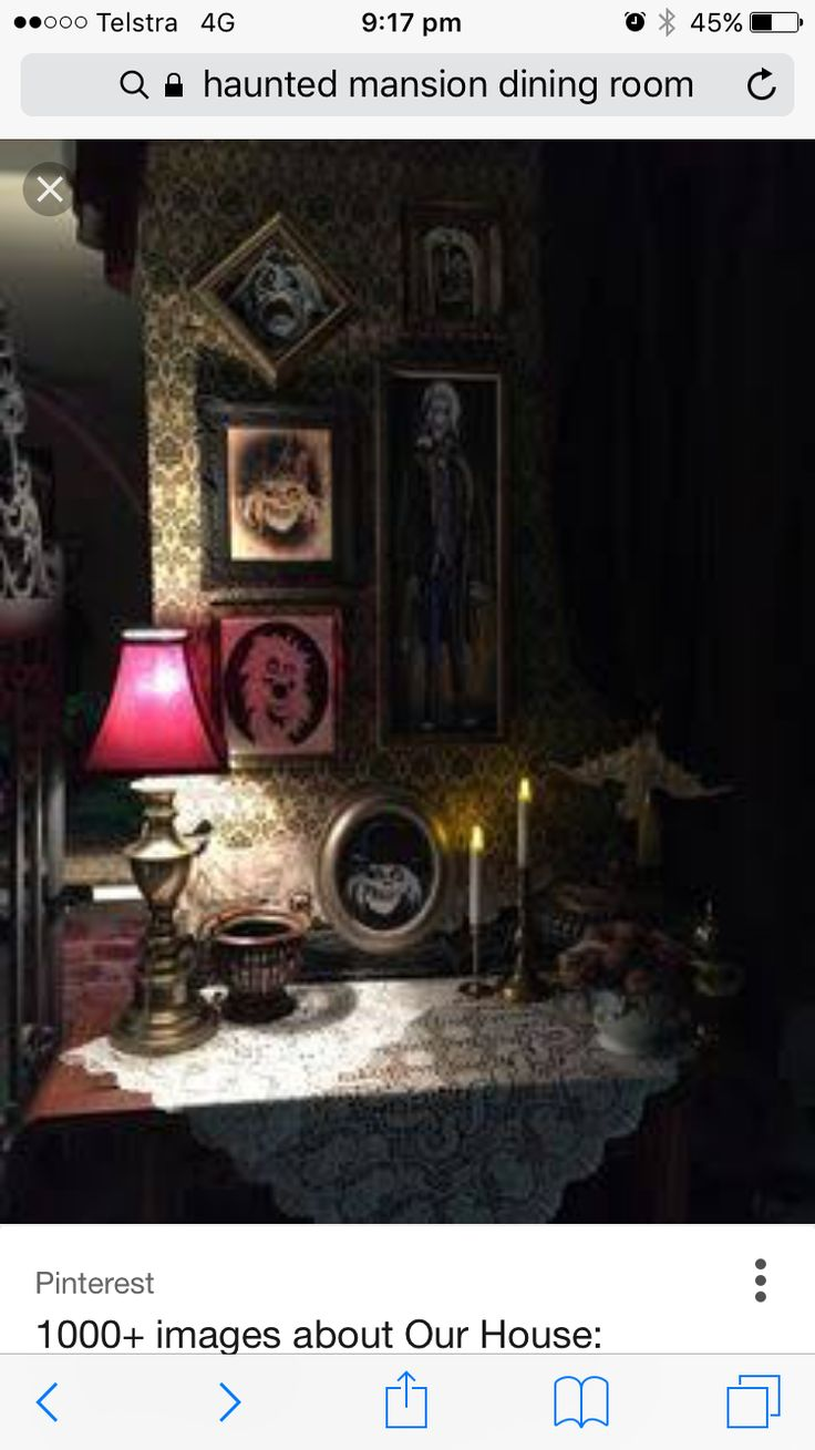 Haunted mansion : photos in mixed frames with drapes & dark lighting