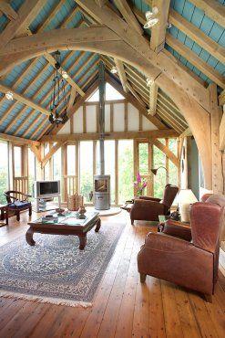 Traditional green oak arch-brace collar frame in house near Helston in Cornwall