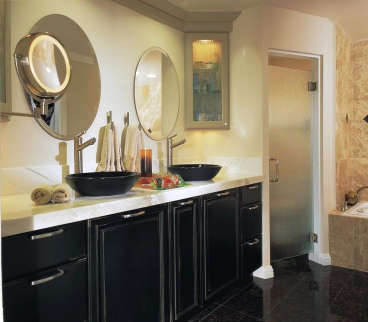 The Awesome Web From neutral paint and light granite to the rich and dark tile floor we love the movement and contrast this The Heirloom Black cabinet finish takes center