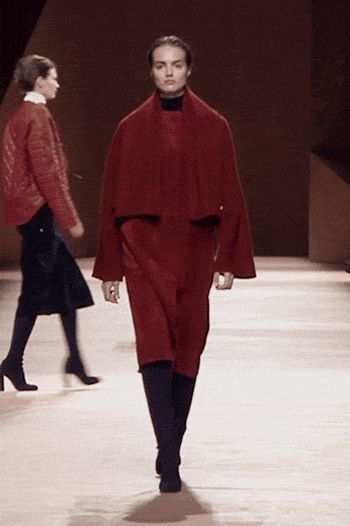 HERMES-AUTUMN-WINTER 2015 Blanket style coat in brick red double-faced cashmere and full grain calfskin, high waisted tapered trousers in blue-black wool gabardine