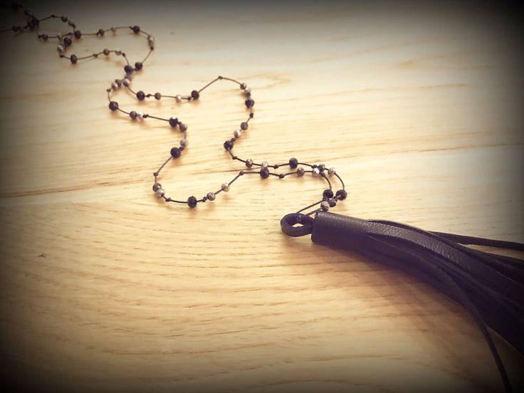 Handmade beaded leather tassel rosary necklace ..