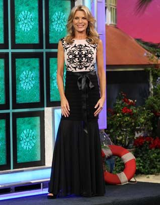 CACHE: Gown w/nude illusion bodice w/black abstract geometric design, round neckline, sleeveless, upper skirt in horizontal pleats, lower skirt in gathered chiffon | Vanna White's dresses | Wheel of Fortune