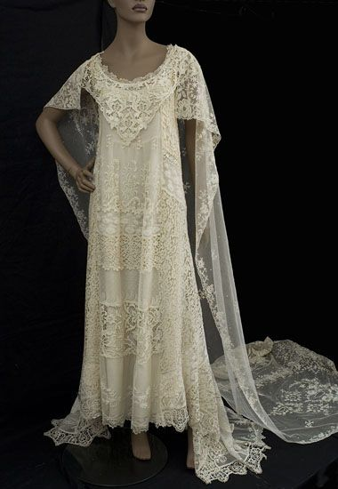 Custom designed from antique lace elements in the 1970s