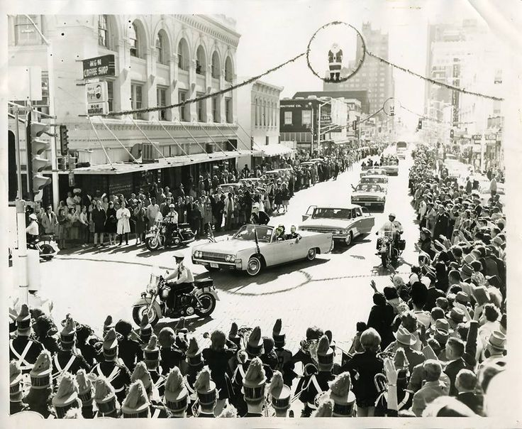The Poly Marching 100 band was on the courthouse steps as JFK's motorcade approached Weatherford Street on Nov. 22, 1963 in Fort Worth, just before his fateful trip to Dallas. The band's drum major gave the president a salute, and JFK returned the salute. If you look closely, you can see his hand as he finishes the salute.