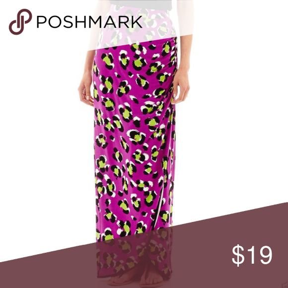 """Gathered-Front Sarong Maxi Skirt Purple Feline Step up your stretch-appeal with our super-soft, elastic-waist maxi skirt, featuring side ruching and an enticing side vent.  43"""" length rayon/spandex hand wash, dry flat imported  Approximate Measurements Taken Laying Flat (unstretched)  Size S: Waist: 14"""" Hips: 19"""" Size L: Waist: 17"""" Hips: 22"""" Size XL: Waist: 18 1/2"""" (stretches out to 26"""")  Hips: 24"""" Worthington Skirts Maxi"""