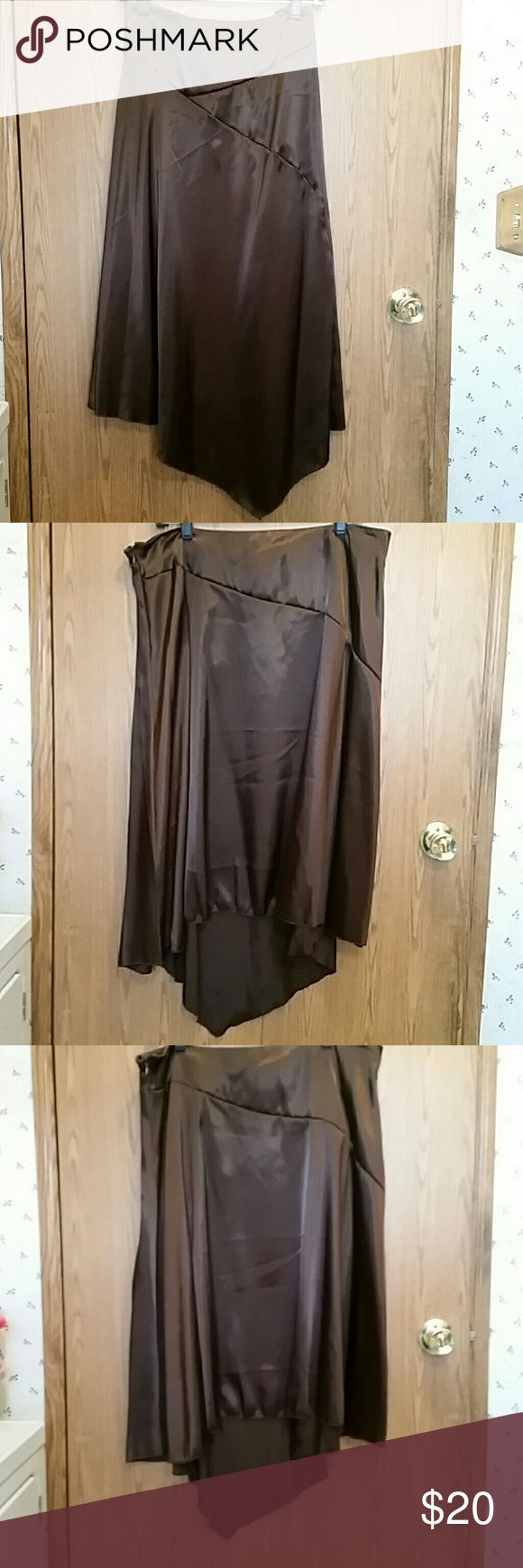 Ashley Stewart Skirt sz 16  NWOT Beautiful chocolate brown skirt feels like silk! Angle hem. New Without Tags. Sz 16. Measures approximately 36 inches at the waist. Angle hem line is 35 inches long. Other side is 26 1/2 inches long. Ashley Stewart Skirts