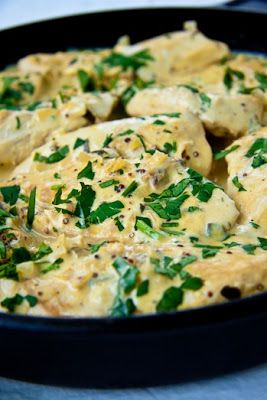 Creamy Dijon Chicken  4 large skinless & de-boned chicken breasts (Left whole, cubed or flattened)  2 large leeks, finely sliced  2 garlic cloves, crushed  250ml (8.45 fluid ounces) cream  2tsp Dijon mustard  1tsp wholegrain mustard  juice of 1/2 lemon  salt & pepper to taste  starch of your choice to serve  fresh Parsley to serve  olive oil for frying