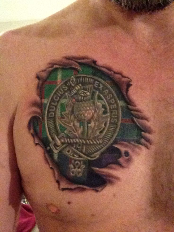Ferguson Clan crest and tartan chest tattoo  ||  I'd have to change it to Clan Munro though.  :)