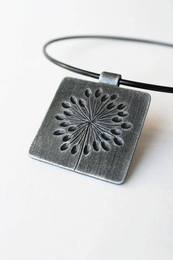 Polymer clay pendant Dandelions (Blowballs). Inspired by nature and the beauty of plants and animals, my collection of polymer clay jewelry is stylish and wearable. The modern, original designs are meant to complement all styles and will pair beautifully with both casual and formal