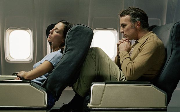 A row between passengers over reclining plane seats has caused a third plane in the US to be diverted in seven days.