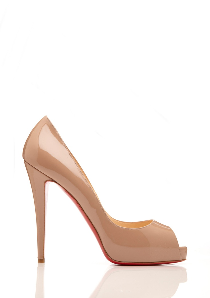 Love these classic nude peep toe pumps by Christian Louboutin!