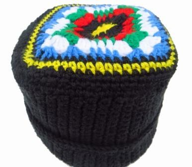 A handmade warm, wool winter beanie inspired by the South African flag. Comfortable and something special.