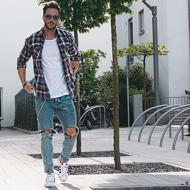 Casual check shirt with destroyed blue jeans.