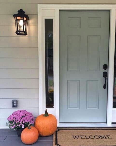 "Front door is ""Oyster Bay"" by Sherwin Williams. Nice blue green paint colour fcr curb appeal"