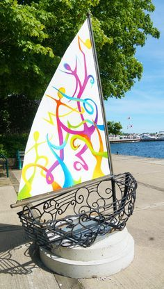 I just love finding street art in the city of Orillia when I visit! Their summer streets alive project is in full swing and this little boat next to their waterfront is one of the old art projects still on display!