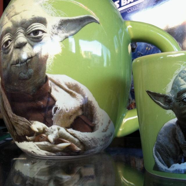 Yoda mugs on display.