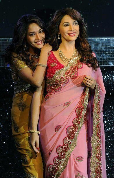 A wax statue of Madhuri Dixit at Madame Tassauds London, with the real life Madhuri standing next to it.