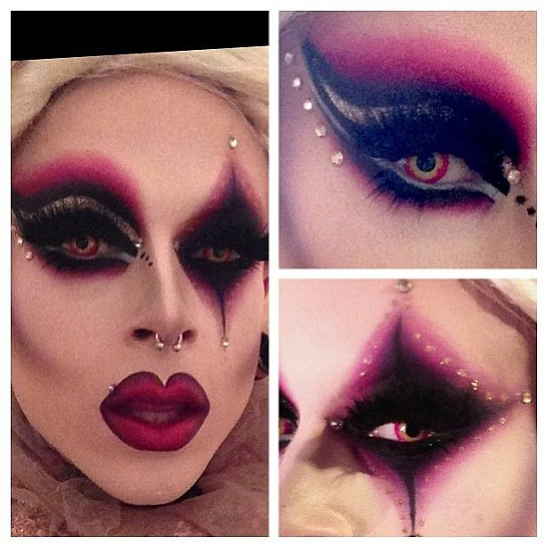 """Colorful """"circus drag"""" fantasy makeup in shades of black and plum accented with jewels... cool idea for Halloween."""