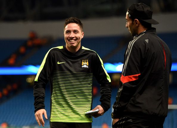 (L-R) Samir Nasri of Manchester City and Mehdi Benatia of Bayern Muenchen chat prior to kickoff during the UEFA Champions League Group E match between Manchester City and FC Bayern Muenchen at the Etihad Stadium on November 25, 2014 in Manchester, United Kingdom.
