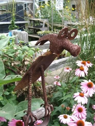 Garden art. Garden junk. Trash to treasure. Garden accoutrements. Found treasure. Curbside finds. Garbage art. Garden crafts. Garden architecture....    Several DIYThere's lots of names for it but it's all the same stuff: cool things to put in the garden besides plants.  Love it!