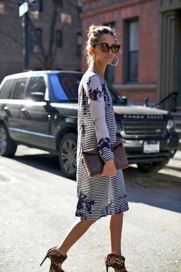 Something Navy blogger wearing a floral dress + cat-eye sunglasses on a warm spring day: