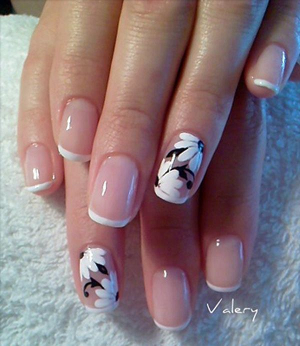 Have glowing looking nails with this elegant French tips. Using light pink as base, the nails are thinly tipped in white. The other nails are accented with white and black floral designs, which is pleasing to the eye.