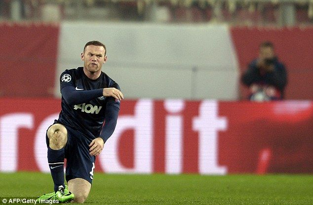 Wayne Rooney reacts to the referee early on after not being given a free-kick
