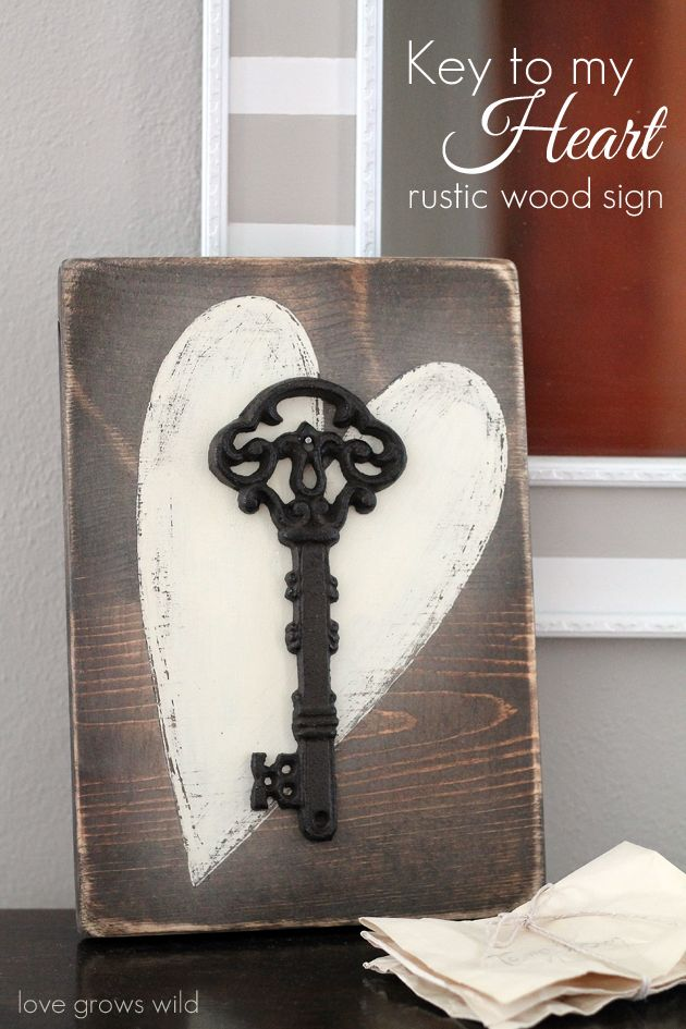 Add a touch of romance to your home with this Key to my Heart Rustic Wood Sign! Find the tutorial at LoveGrowsWild.com