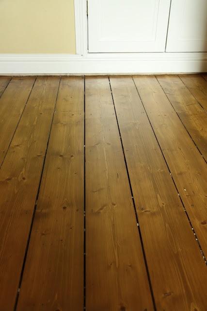 Medium Oak stained floorboards